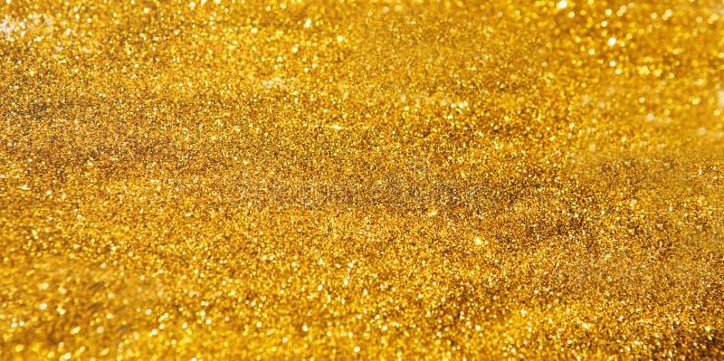 De achtergrond van Kerstmis De gouden Vakantiesamenvatting schittert Achtergrond royalty-vrije stock foto