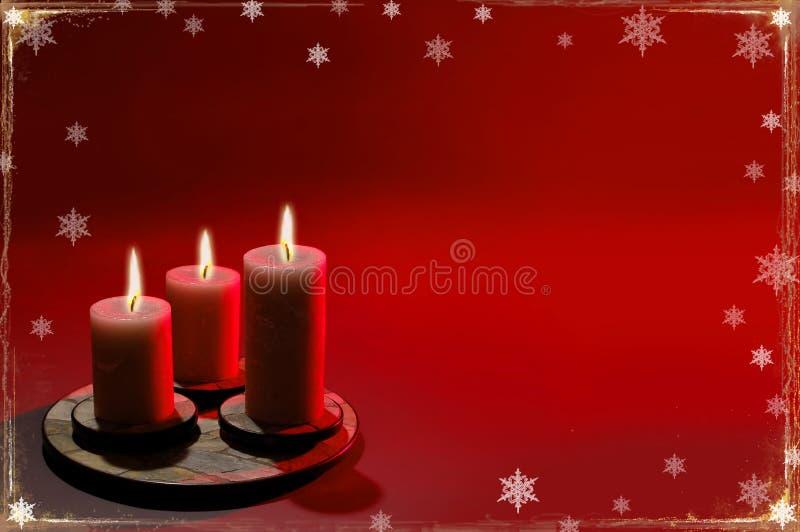 De Achtergrond van Kerstmis met Drie Kaarsen stock afbeeldingen