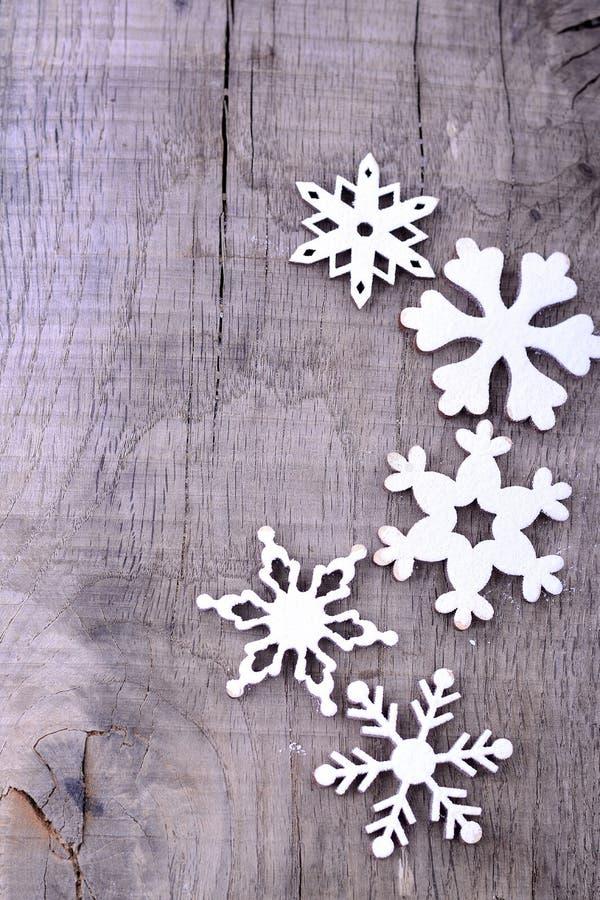De achtergrond van Kerstmis met sneeuwvlokken stock foto