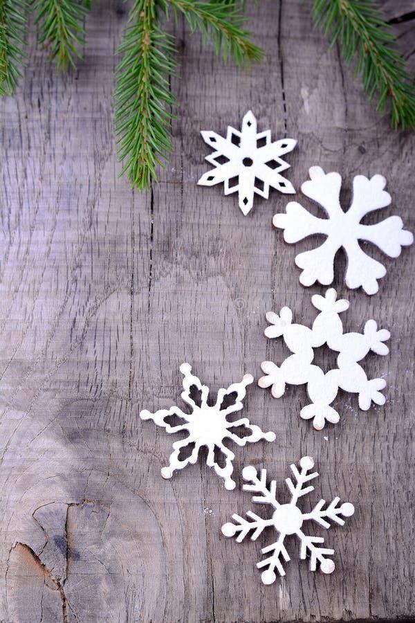 De achtergrond van Kerstmis met sneeuwvlokken royalty-vrije stock afbeelding