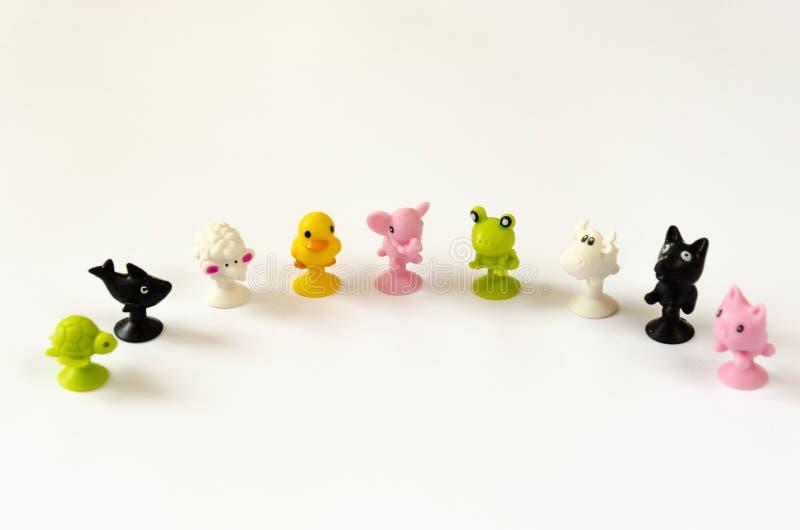 De achtergrond van kinderen Kleurrijk rubberdierenstuk speelgoed voor babyjonge geitjes Frame voor tekst De vector van de illustr royalty-vrije stock foto