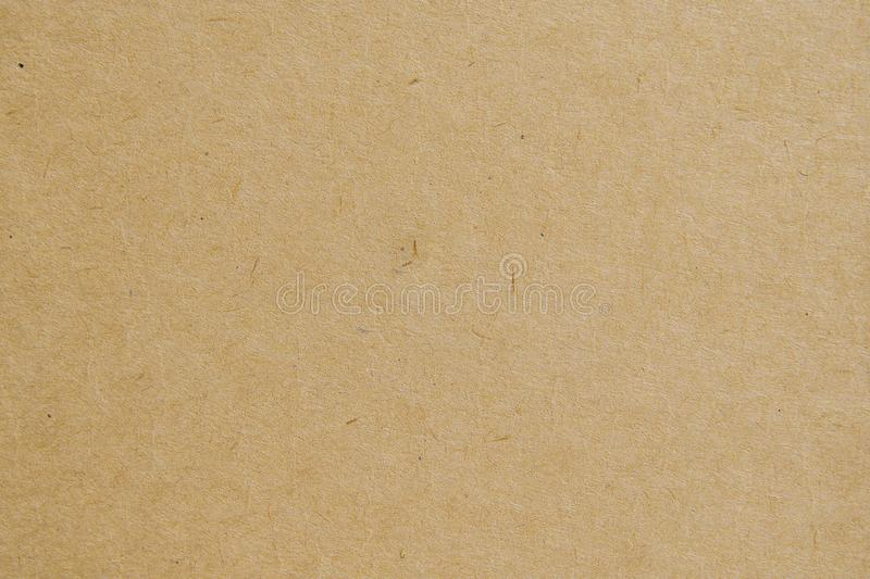 De achtergrond van de pakpapiertextuur gebruikt ons kraftpapier-kantoorbehoeften of kartonnen ontwerp als achtergrond stock afbeelding