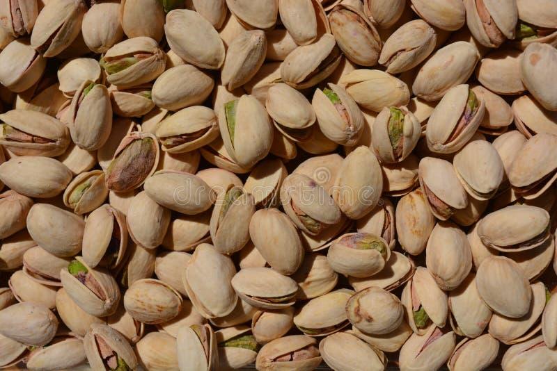 De achtergrond van pistachenoten, sluit omhoog, volledig kader royalty-vrije stock afbeelding
