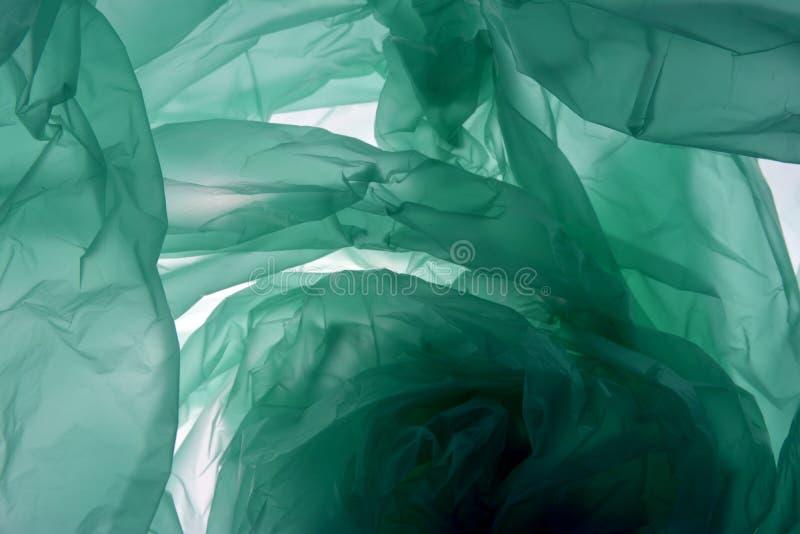 De achtergrond van de polyethyleenzak Textuur met exemplaarruimte voor tekst Plastic concept Groen ge?soleerd op achtergrond voor stock foto