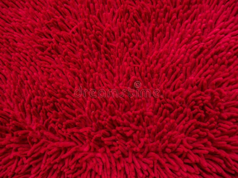 De achtergrond van rode tapijt of voetschraper, sluit omhoog beeld royalty-vrije stock foto's