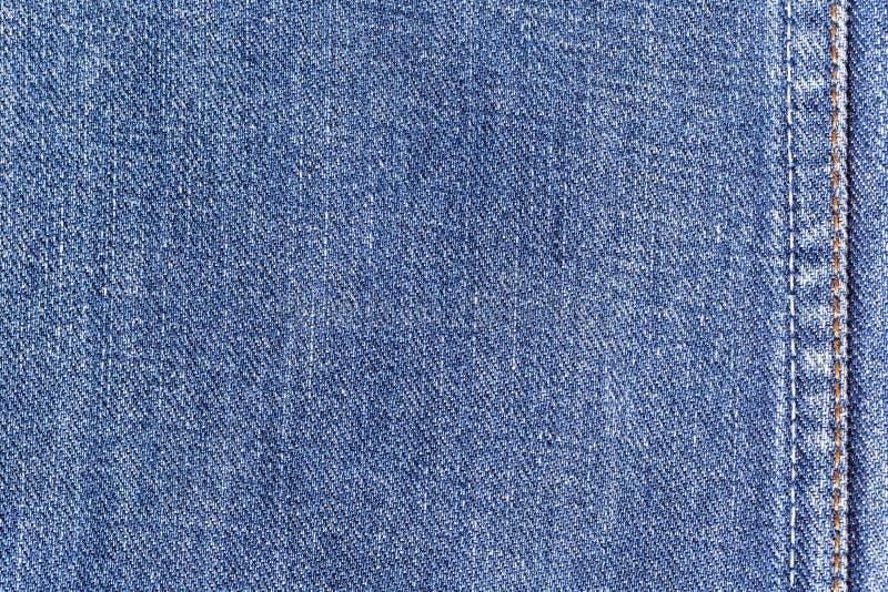 De achtergrond van de de stoffentextuur van denimjeans met naad voor kleding, manierontwerp en industrieel bouwconcept royalty-vrije stock afbeeldingen