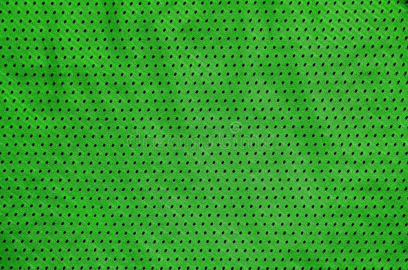 De achtergrond van de de stoffentextuur van de sportkleding Hoogste Mening van Doek Textieloppervlakte Gekleurd Basketbaloverhemd royalty-vrije stock foto