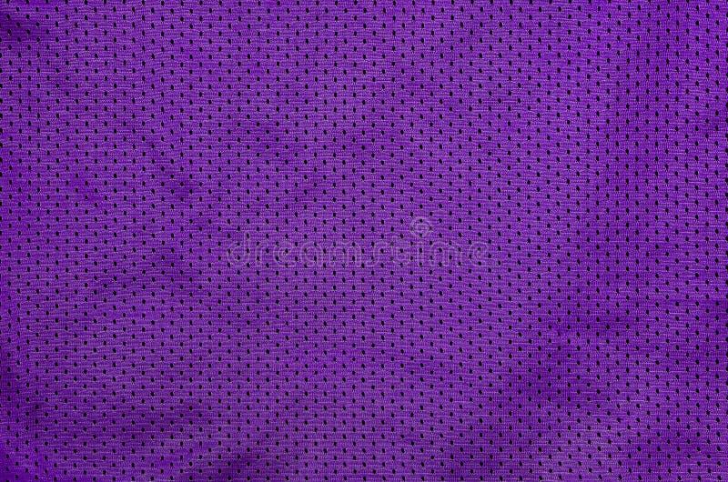 De achtergrond van de de stoffentextuur van de sportkleding Hoogste Mening van Doek Textieloppervlakte Gekleurd Basketbaloverhemd royalty-vrije stock foto's