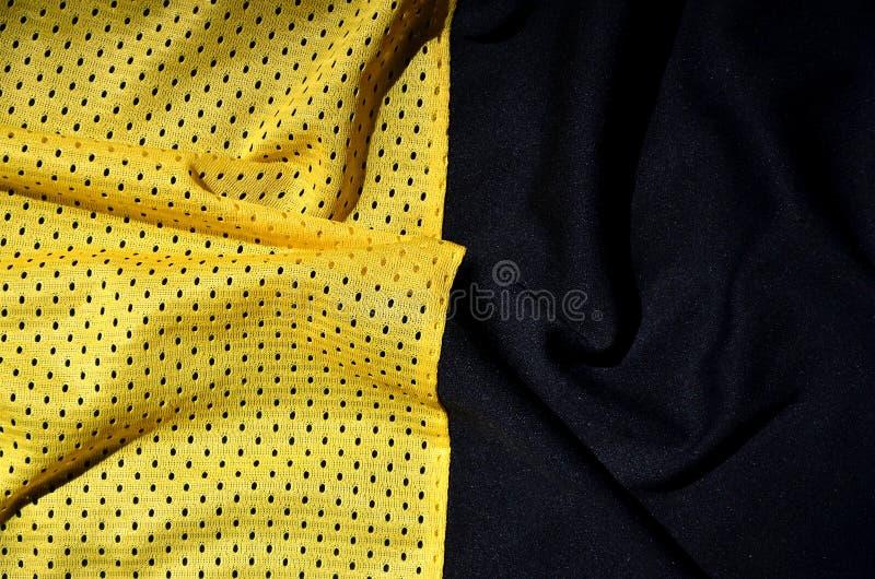 De achtergrond van de de stoffentextuur van de sportkleding Hoogste mening van de gele textieloppervlakte van de polyester nylon  royalty-vrije stock afbeelding