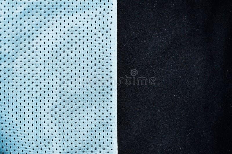 De achtergrond van de de stoffentextuur van de sportkleding Hoogste mening van de lichtblauwe textieloppervlakte van de polyester royalty-vrije stock foto's