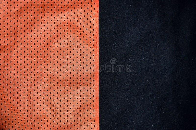 De achtergrond van de de stoffentextuur van de sportkleding Hoogste mening van de rode textieloppervlakte van de polyester nylon  stock foto