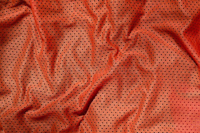 De achtergrond van de de stoffentextuur van de sportkleding Hoogste mening van de rode textieloppervlakte van de polyester nylon  stock afbeeldingen