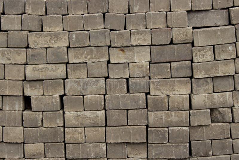 De achtergrond van de de straatstenentextuur van bakstenenstenen, stapelt een stapel van straatstenenclose-up stock foto