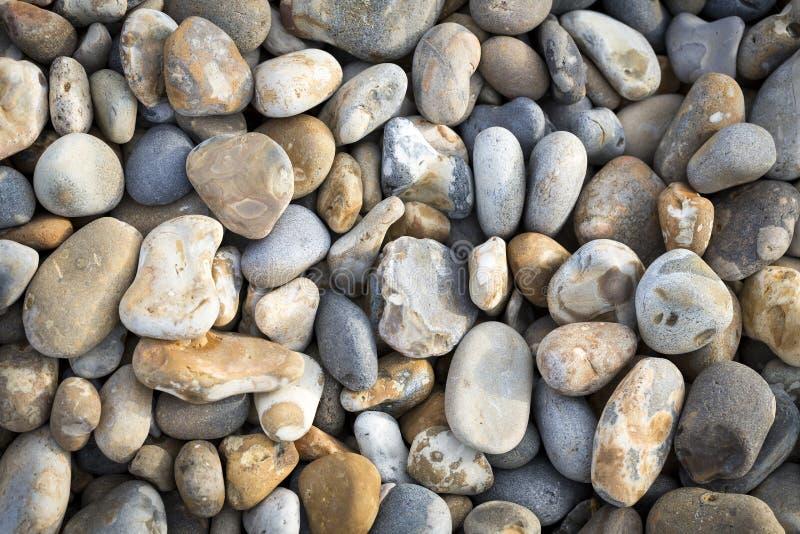 De achtergrond van strandkiezelstenen royalty-vrije stock afbeelding