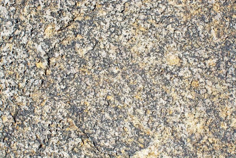 De achtergrond van de de textuurclose-up van de granietoppervlakte stock foto