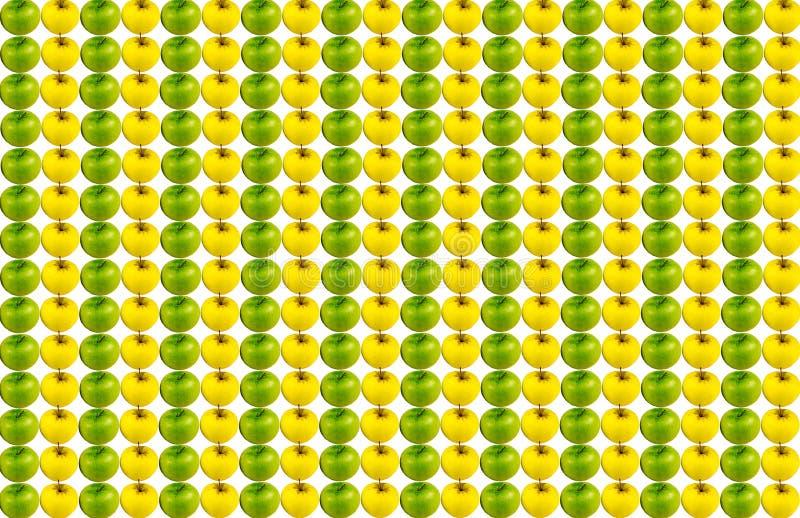 De achtergrondcanvas verticale rij van sappige groene appelreeks gele vruchten herhaalde zonder het ophouden stock foto