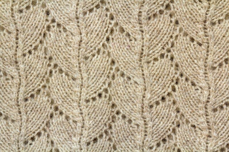 De achtergrondtextuur van beige die patroon breide stof van cotto wordt gemaakt royalty-vrije stock fotografie
