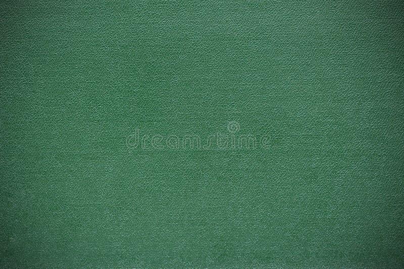 De achtergrondtextuur wordt gemaakt van het groene vignet van de boekdekking stock illustratie