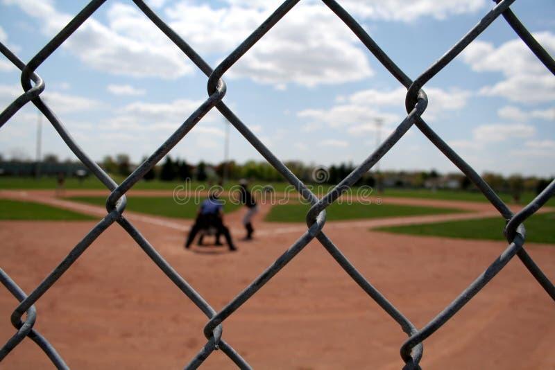 De Actie van het honkbal door de Links stock afbeelding