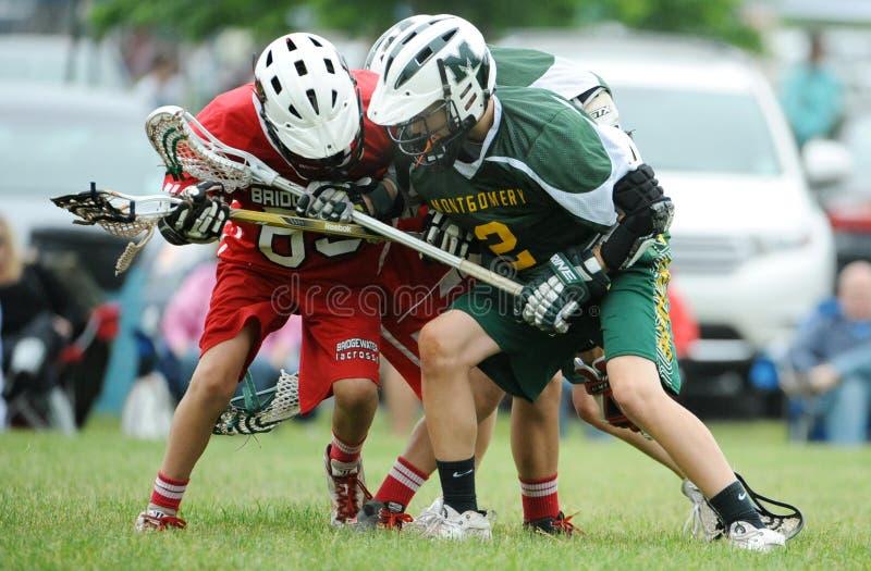 De Actie van de de jeugdlacrosse royalty-vrije stock afbeelding