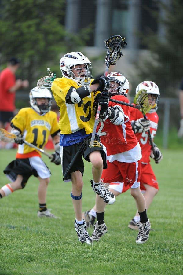 De Actie van de de jeugdlacrosse royalty-vrije stock afbeeldingen