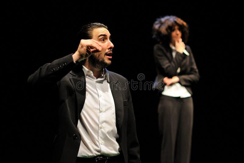 De actoren kleedden zich in stafmedewerker van het het Theaterinstituut van Barcelona royalty-vrije stock afbeeldingen