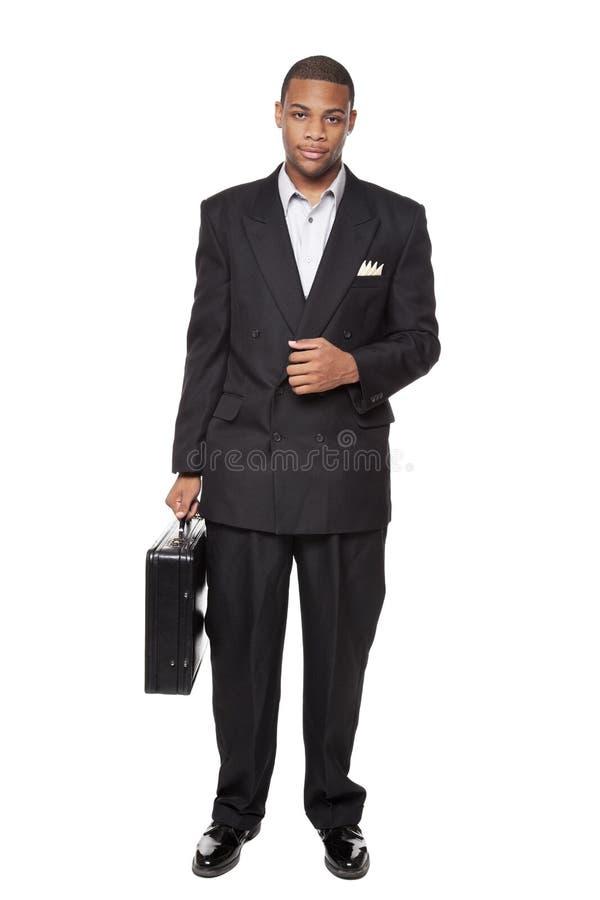 De Afrikaanse Amerikaanse aktentas van de zakenmanholding stock afbeeldingen