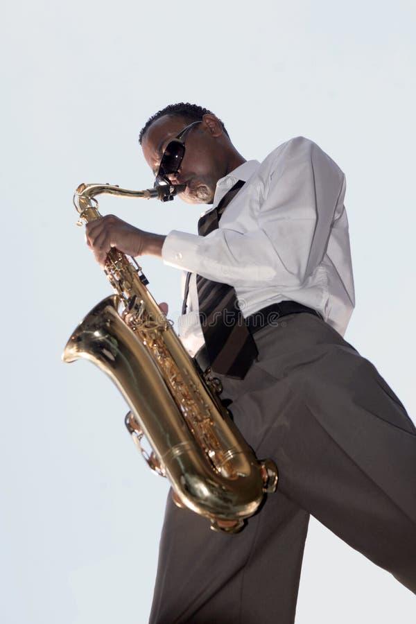 De Afrikaanse Amerikaanse Speler van de Muziek van de Jazz stock afbeeldingen