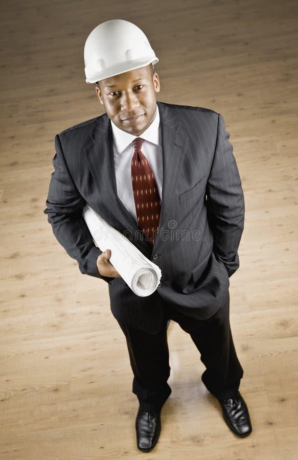 De Afrikaanse blauwdrukken van de zakenmanholding royalty-vrije stock foto