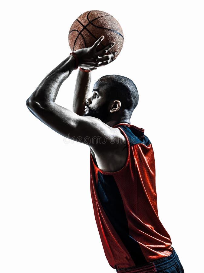 De Afrikaanse vrije speler van het mensenbasketbal werpt silhouet stock afbeelding