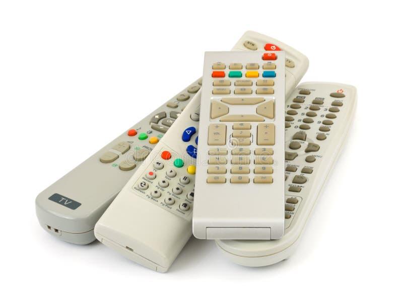 De afstandsbedieningen van TV stock afbeeldingen