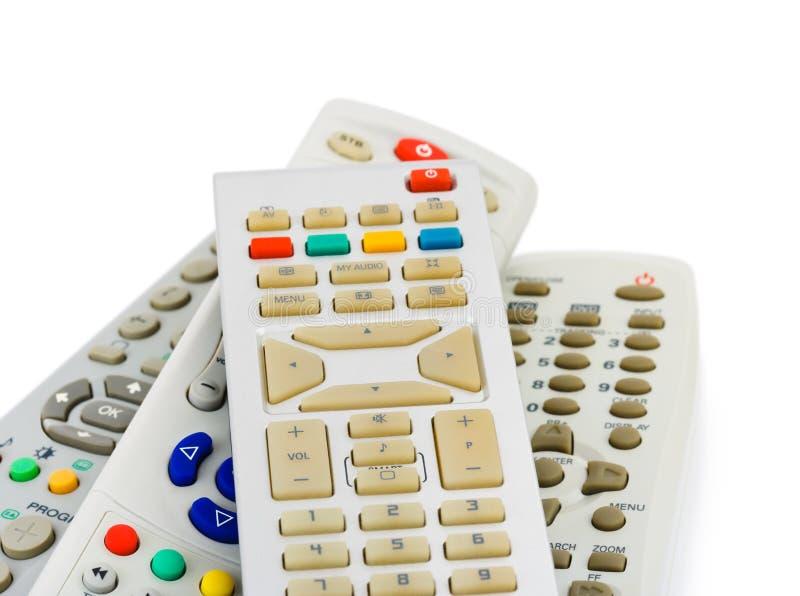 De afstandsbedieningen van TV stock foto