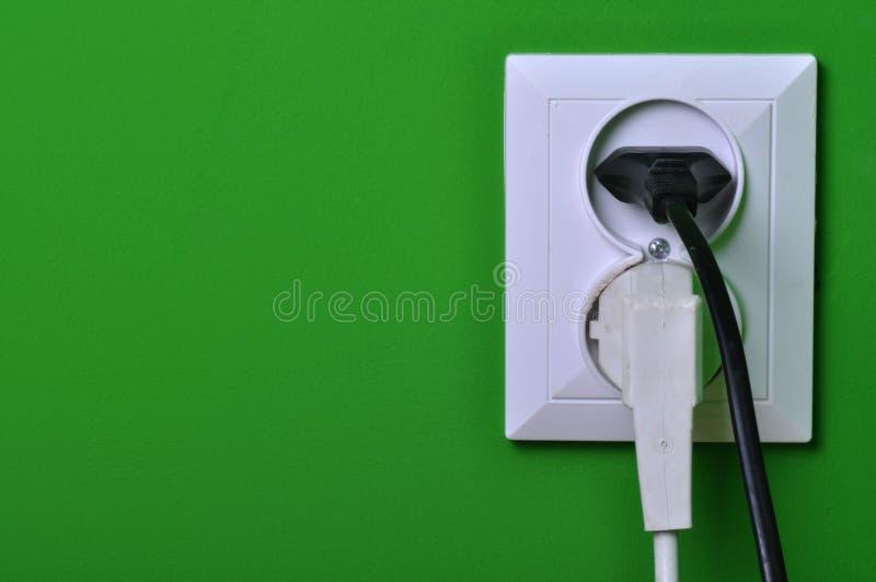 De afzet van de muur op de groene muur royalty-vrije stock afbeeldingen