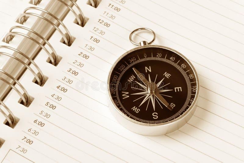 De agenda en het kompas van de kalender stock foto