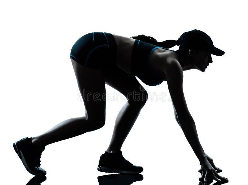 De agent van de vrouw jogger op het startblok stock foto's