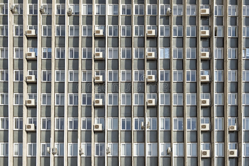 De airconditioners van Mani op de muur van de bureaubouw royalty-vrije stock afbeelding
