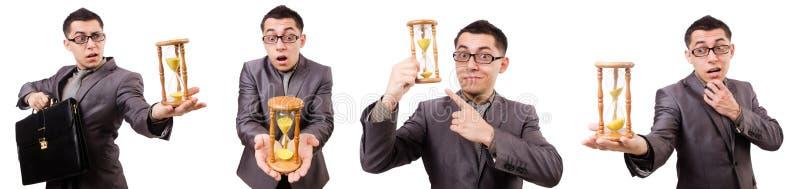 De aktentas van de jonge mensenholding en sandglass geïsoleerd op wit royalty-vrije stock afbeelding
