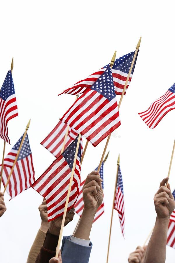 De Amerikaanse Vlag van de handenholding royalty-vrije stock foto's