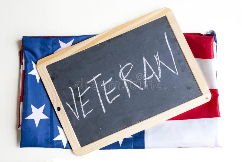 De Amerikaanse vlag viert veteranen royalty-vrije stock afbeeldingen