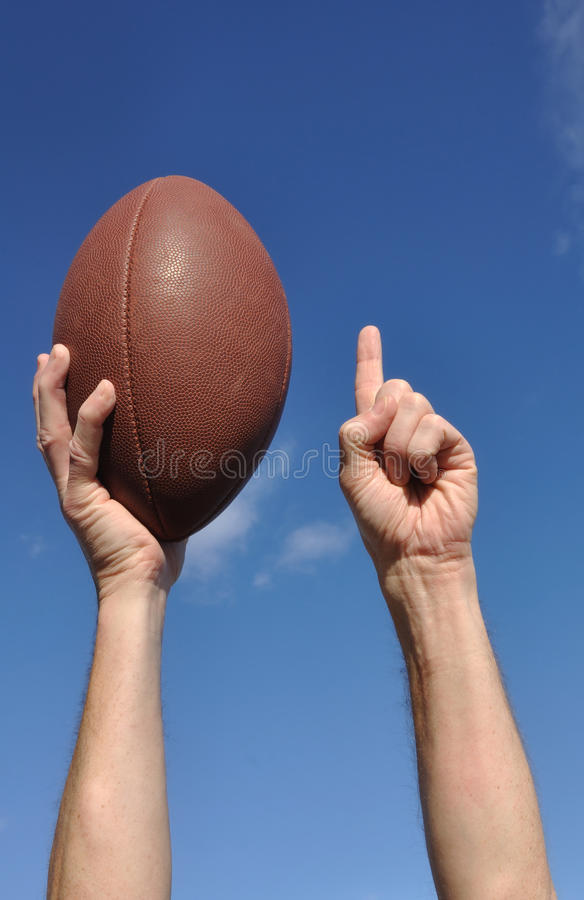 De Amerikaanse Voetbalster viert een Touchdown stock afbeelding