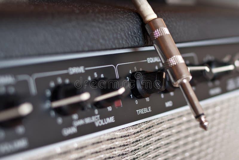 De ampère en de hefboom van de gitaar stock afbeelding