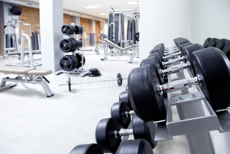 De apparatuur van het de clubgewichtheffen van de geschiktheid gymnastiek stock fotografie