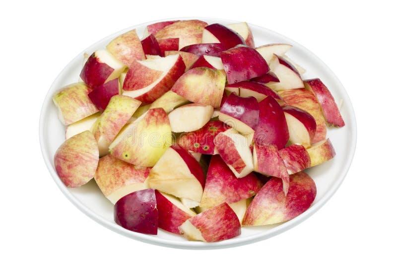 De appelen worden gesneden op reepjes stock foto