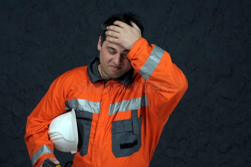 De arbeider van de mijn het vegen stock foto