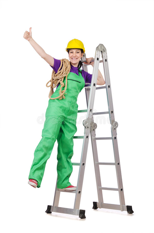 De arbeider van de vrouw op ladder stock foto