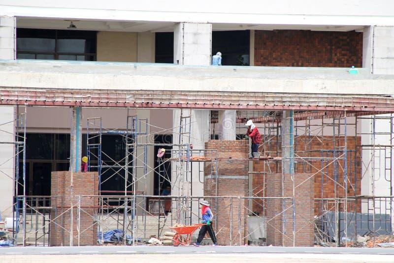 De arbeiders in aanbouw is het Teamwerk royalty-vrije stock foto's