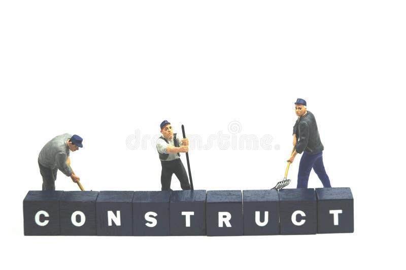 De arbeiders achter woord construeren stock afbeeldingen