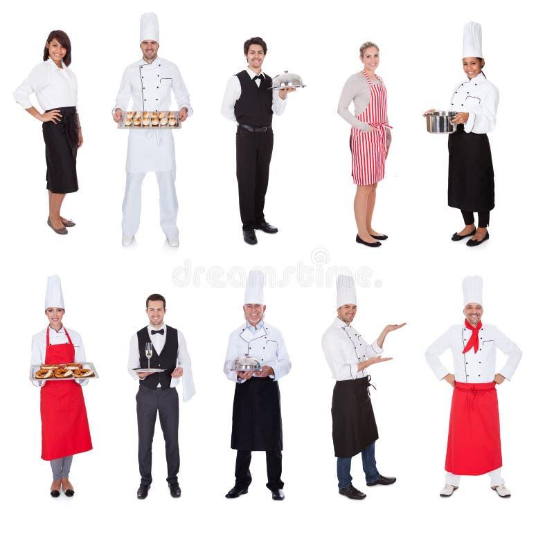 De arbeiders, de koks, de kogels en de kelners van het restaurant stock foto