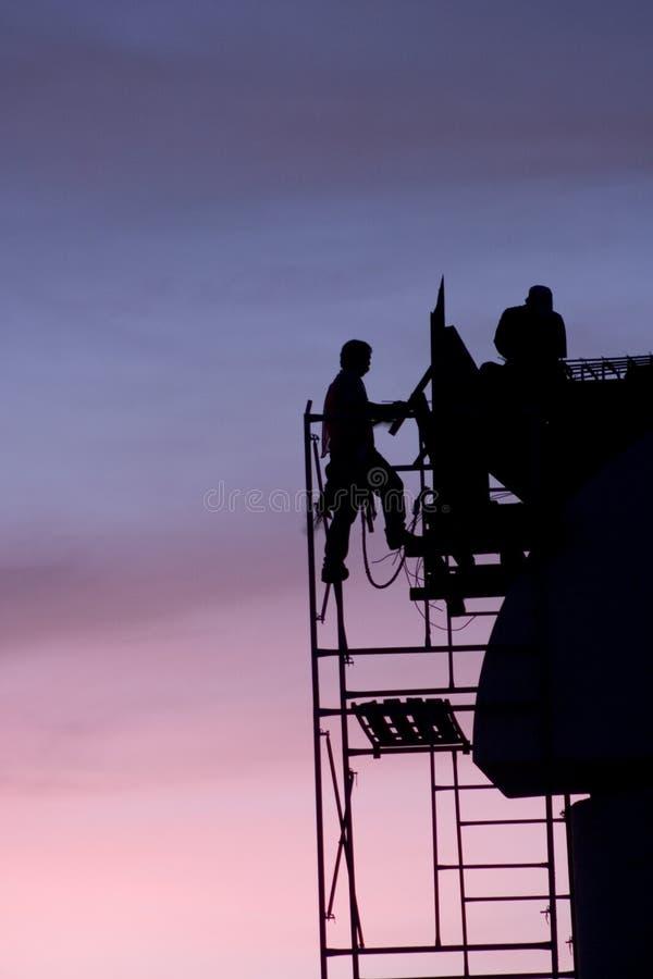 De arbeiders silhouetteren stock afbeeldingen