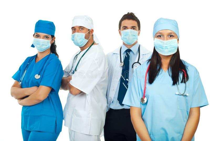 De arbeiders van de gezondheidszorg met beschermend masker stock fotografie